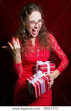 Young Woman With Two Striped Gift Boxes Screams