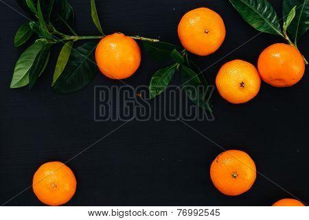 Heap of mandarins on a black background