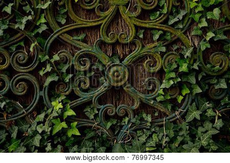 Fence with woven in leaves.