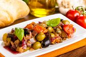 stock photo of brinjal  - tasty homemade caponata - mixed sweet and sour vegetables