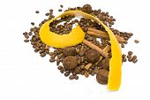picture of cocoa beans  - yellow peel of the ripe grapefruit spiral sliced coffee beans chocolate truffles and cinnamon sticks on the white background - JPG