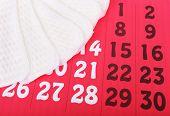 stock photo of menses  - Sanitary pads on red calendar background - JPG