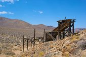 picture of gold mine  - Wooden structure of an antique gold mine at a site in California - JPG
