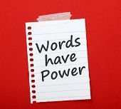 stock photo of power lines  - The phrase Words Have Power printed on a scrap of lined paper and taped to a red notice board - JPG