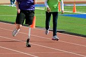 image of crippled  - Blade runner at track running fast with carbon blade - JPG