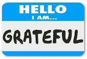 pic of thankful  - Hello I Am Grateful words on a name tag sticker telling others you are thankful and appreciative for the valuable things in your life such as health - JPG