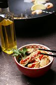 picture of chinese wok  - Chinese noodles with vegetables and seafood in bowl and wok on wooden background - JPG