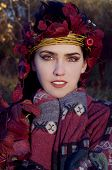 picture of pixie  - beautiful brunette in autumn red leaves looking like pixie - JPG