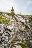 stock photo of cross hill  - Small Church Chapel and Jesus Christ Cross on the Rocky Hill - JPG
