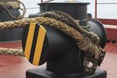 stock photo of bollard  - mooring rope attached to the ship - JPG