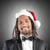 foto of rasta  - A smiling businessman with rasta celebrates Christmas - JPG
