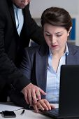foto of inappropriate  - Young attractive boss touching the young woman - JPG