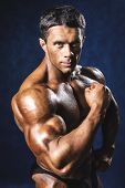 picture of bodybuilder  - Muscular man bodybuilder - JPG