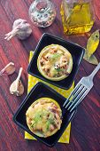 foto of marrow  - marrow stuffed with cheese and meat in bowl - JPG