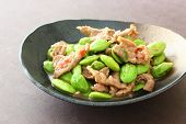 stock photo of stinky  - Thai style stir fry pork with Parkia beans and shrimp paste  - JPG