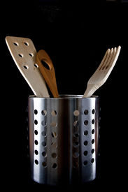 stock photo of kitchen utensils  - Three kitchen utensils made of wood in a metalic container - JPG