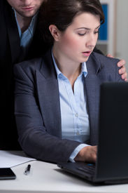foto of inappropriate  - Young boss and his inappropriate behaviour at workplace - JPG