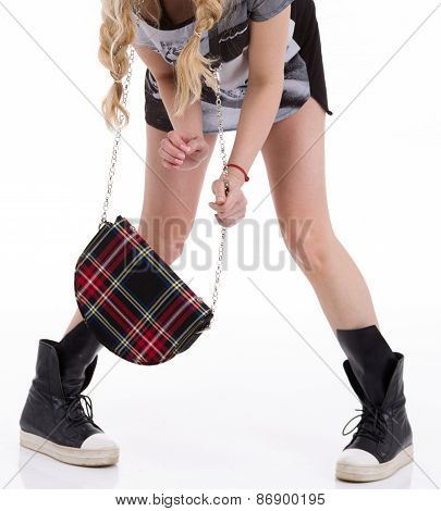 Woman sneakers mini dress holding a bag