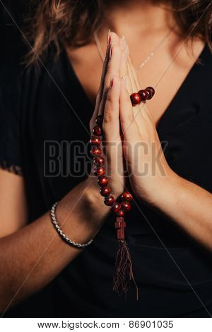 Young Woman  Praying With Rosary In Hand