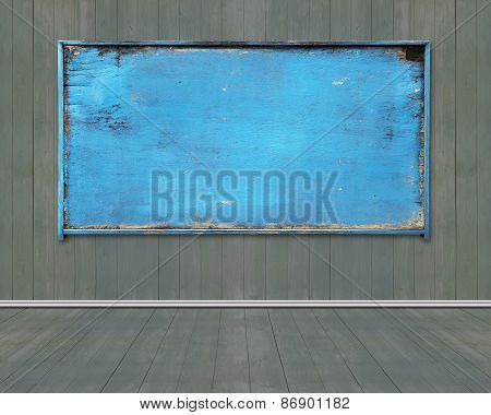 Old Blue Blank Weathered Noticeboard On Dark Green Wooden Wall