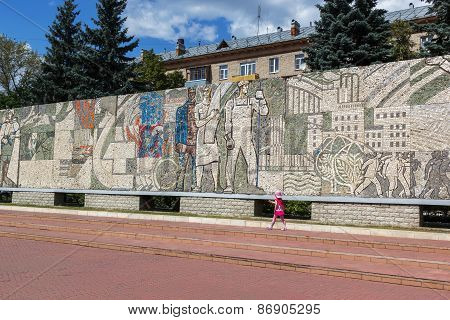 KOROLEV, RUSSIA - JULY 20, 2014: Child Walks Near Mosaic On The Central Square