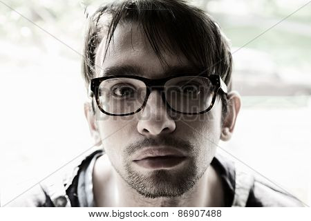 Young Brunette Man With Glasses