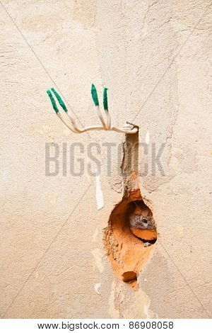 hole in the wall for AC power socket