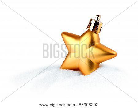 Golden Christmas Star In Snow