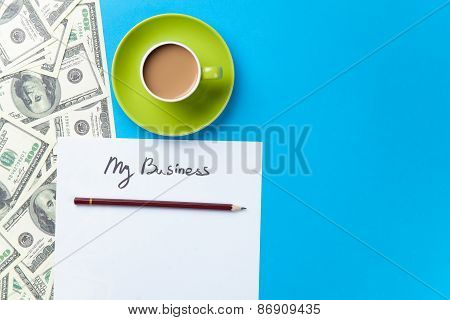 Cup Of Coffee And Paper With Inscription