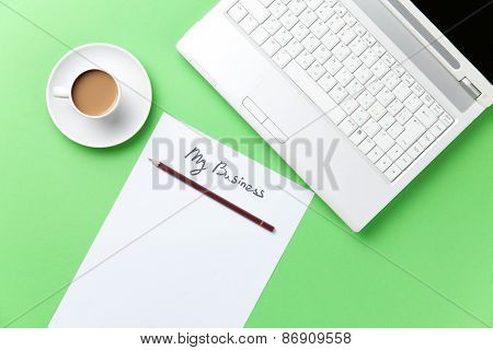 Cup Of Coffee And Computer With Paper
