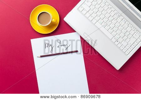 Cup Of Coffee And Computer With Paper And Pencil