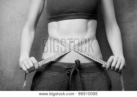 Woman Showing Her Abs With Metric After Weight Loss