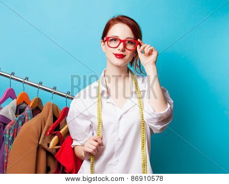 Young Redhead Designer With Metric And Clothes