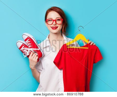 Young Redhead Designer With Dress And Gumshoes
