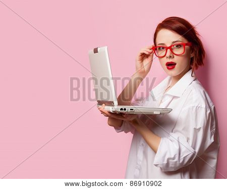 Surprised Redhead Girl In White Shirt With Computer