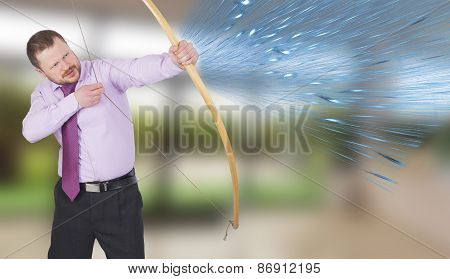 Businessman practicing archery with modern interior in background