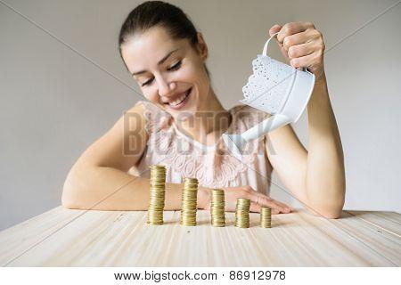 Woman pours coins