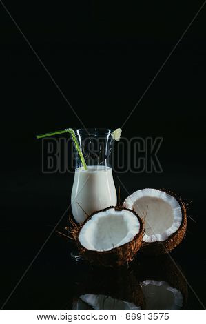 Pina Colada Over Black Background, Garnished With  Coconut.