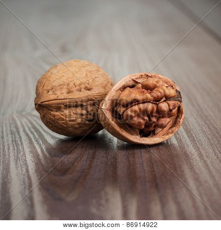 walnuts on the brown wooden table