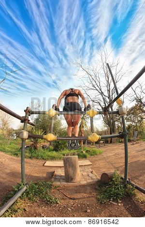 Bodybuilder At Parallel Bars
