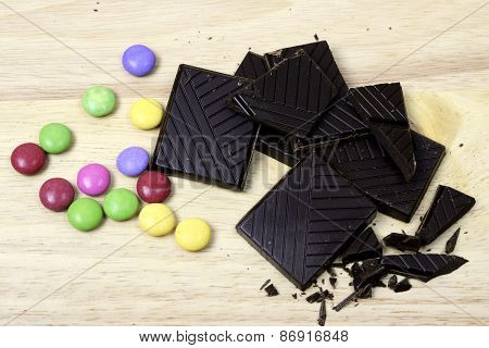 Dark chocolate with colored bonbons