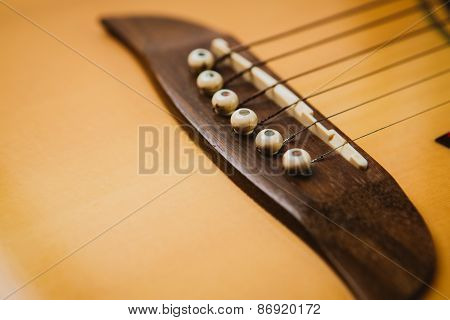Macro Shot Down The Fretboard Of Acoustic Guitar With Shallow Depth Of Field
