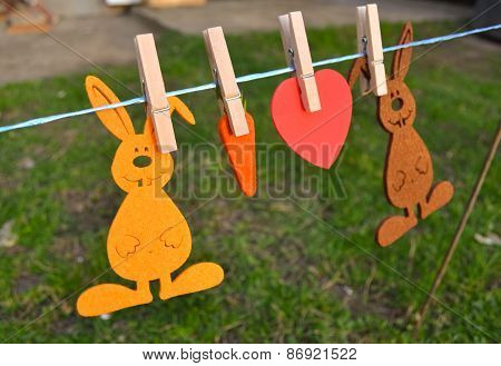 Bunnies and Carrots toy hanging on rope to dry.