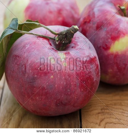fresh red apples on brown wooden table