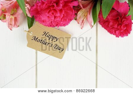 Mother's Day gift tag with flowers on white wood