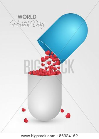 Red glossy hearts coming out from a capsule pill for World Health Day concept on grey background.