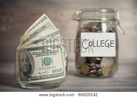 Dollars and coins in glass jar with college label, financial concept. Vintage tone wooden background with dramatic light.
