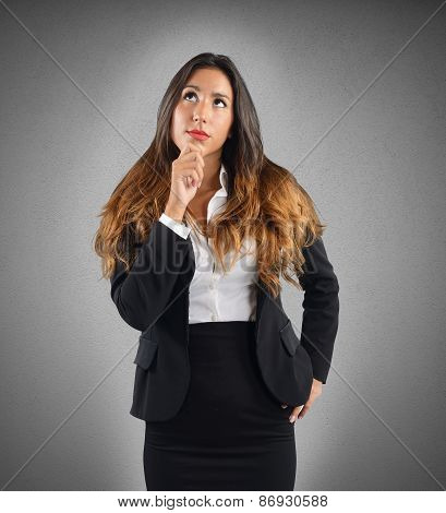 Reflective and thoughtful businesswoman
