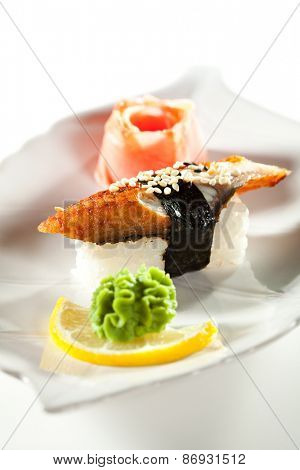 Japanese Cuisine -  Smoked Eel Nigiri Sushi with Ginger and Wasabi