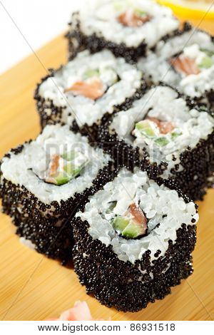 Roll with Smoked Salmon, Cream Cheese, Cucumber inside. Black Tobiko outside